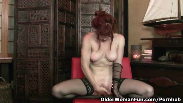 Redheaded milf amber dawn looks so lewd in dark underware