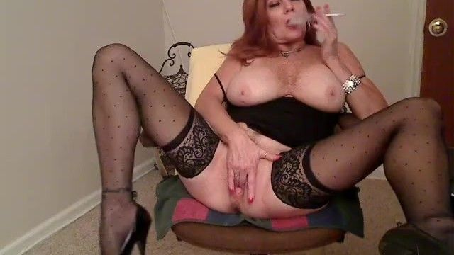 Redhead milf smokin 120s and masturbating 1